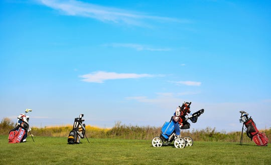 Golf club bags sit on a hill during the final round of the Boys City Golf meet on Tuesday, September 24, at Elmwood Golf Course in Sioux Falls.