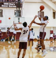 Ja'Monta Black (right) shoots a basket over Ford Cooper during a Missouri State basketball practice on Tuesday, Sept. 24, 2019.