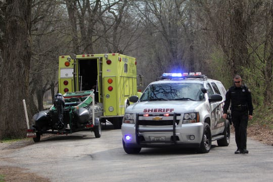 The Greene County Sheriff's Office investigates the scene where a body was found in the James River near Crighton Access on Thursday, March 15, 2012.
