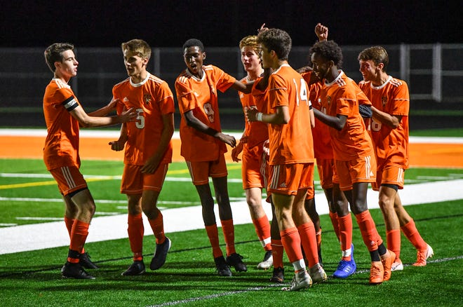 Tech players celebrate a goal during the first half of the Monday, Sept. 23, 2019, game at Tech High School in St. Cloud.