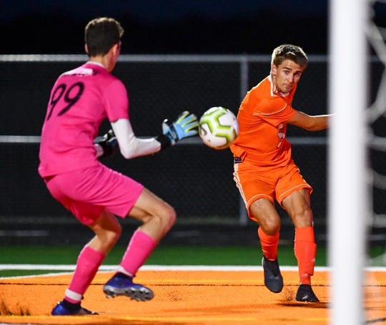 Tech's Ethan Miller takes a shot on Apollo goaltender Calvin Walters during the first half of the Monday, Sept. 23 , 2019, game at Tech High School in St. Cloud.