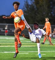 St. Cloud Tech's Mohamad Yussuf and Ali Arab of Apollo try to get control of the ball during their match Sept. 23 , 2019, game at Tech High School in St. Cloud. Tech earned the No. 1 seed in the southern bracket for the Section 8A playoffs.
