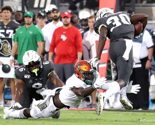 FAMU nickelback Terry Jefferson dives to make a tackle on UCF running back Greg McCrae.