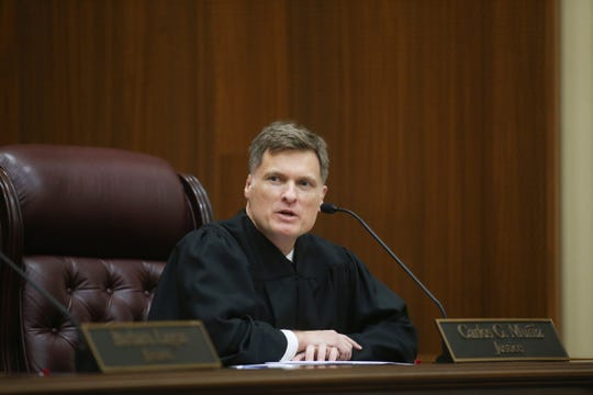 Newly enrobed Supreme Court Justice Carlos Muñiz speaks during an investiture ceremony held for Supreme Court Justices Muñiz and Robert Luck at the Supreme Court of Florida Tuesday, Sept. 24, 2019.