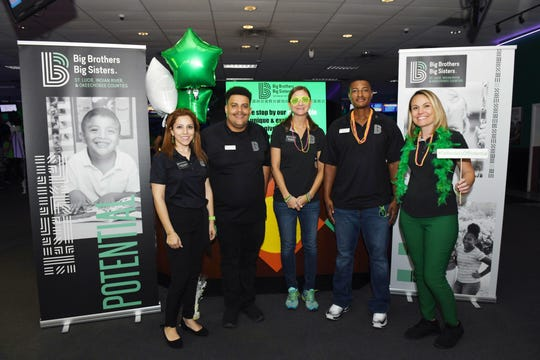Match Support Specialists Christina Paniagua, left, Azzam Abdur-Rahman, Kari Tankersley, Kwabend Maycock and Diana Embick at the 2019 Bowl for Kids' Sake event for Big Brothers Big Sisters of St. Lucie, Indian River & Okeechobee Counties in St. Lucie West.