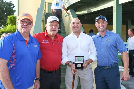 Port St. Lucie Police Chief John Bolduc, left, Dave Hentz, Congressman Brian Mast and Assistant Police Chief Rich Del Toro at the Port St. Lucie Police Athletic League's 2019 Golf Tournament.