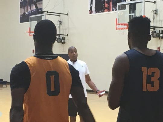 Rodney Terry instructs Souley Boum (left) and Ountae Campbell at the end of Monday's workout in the Foster-Stevens Center