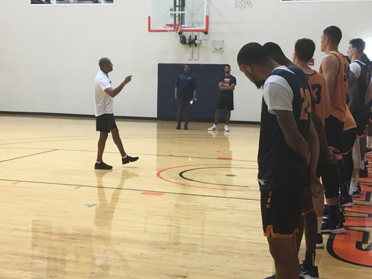 Coach Rodney Terry instructs the UTEP basketball team at the end of Monday's workout in the Foster-Stevens Center