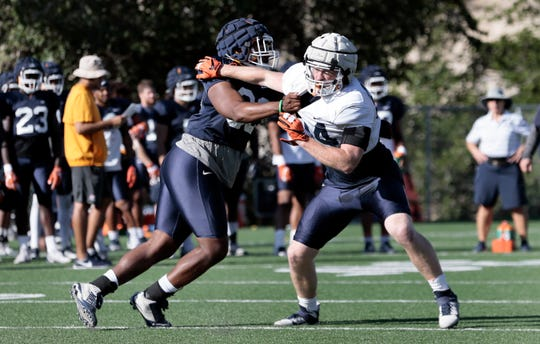 UTEP tight end Jess Trussel tries to peel off a block during the MIners' practice Tuesday at Glory Road Field.