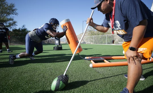UTEP defensive tackle Dedrick Simpson does a blocking drill during the Miners' practice Tuesday at Glory Road Field.