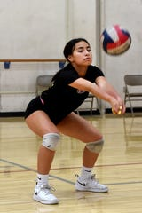 Oxnard High sophomore Emily Ordonez bumps the ball during a team practice on Monday. The libero is a defensive leader for a strong and deep Yellowjackets team.