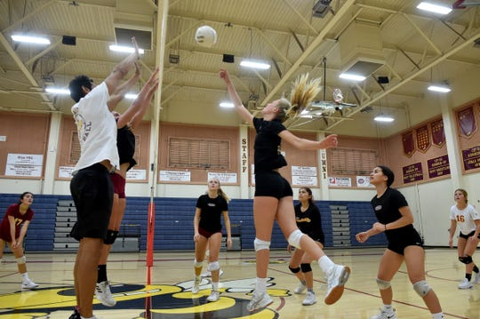 Oxnard High freshman Anika Huelskamp spikes the ball during a team practice on Monday. A 5-foot-11 outside hitter, Huelskamp is a rarity for the Oxnard program — a freshman starter. The Yellowjackets are off to a 13-6 start, including 4-0 in the Pacific View League.