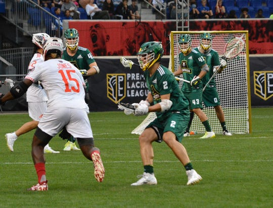 Jack Near (2) a former Bronxville standout sets up to deal with Chaos midfielder Myles Jones during a Redwoods win in a PLL semifinal at Red Bull Arena on Sept. 14, 2019.