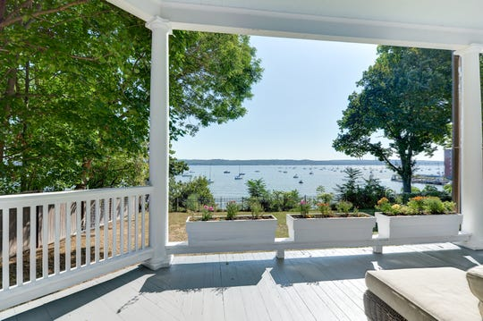 The Nyack home features a wraparound porch with views of the Hudson River.