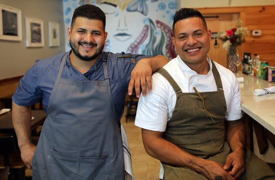 From left, brothers Kevin and Elmer Oliveros owners of the three-year-old Brothers Fish and Chips, photographed in their restaurant in Ossining Sept. 23, 2019.