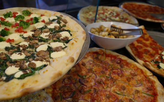A variety of pizzas are on display at Dom's New York Style Pizza in Newport.