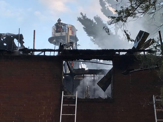 Officials respond to a fire at the Fairfield Apartments on Country Club Drive in Newark.