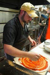 Dom Filingeri makes pizza at his Dom's New York Style Pizza in Newport.