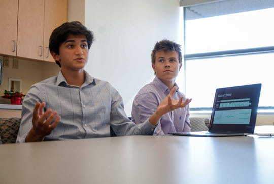 Rohan Kanchana, 16, a junior at Newark Charter, talks about how he used his coding skills to create a program to analyze gene editing results. Ben Dupont, 17, a senior at Tower Hill, listens on.