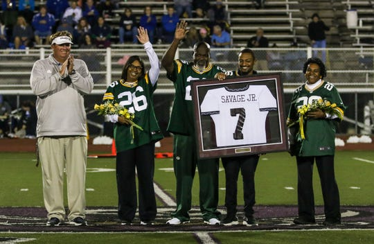 Green Bay Packers rookie Darnell Savage (not pictured) has his Caravel Academy number retired during a Sept. 13 game as his family holds up his jersey.