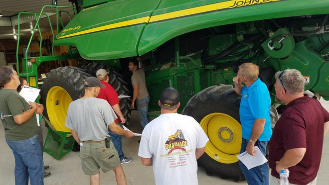 Grain farmers gathered at the Nell Farm at Juneau to learn about the importance of removing weed seeds from combines before harvest, during harvest and after harvest.  2019 will likely be a challenging year for controlling weed seeds at the time of harvest.  Ryan Nell pointed out spots that need particular attention for cleaning out seeds.