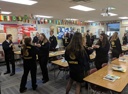 FFA members engage in several different hands-on workshops with a series of topics ranging from leadership training to FFA opportunities to agricultural careers. Pictured are chapter presidents at the Section 10 SLW in Watertown learning about the importance of delegation through a communication and teamwork activity.