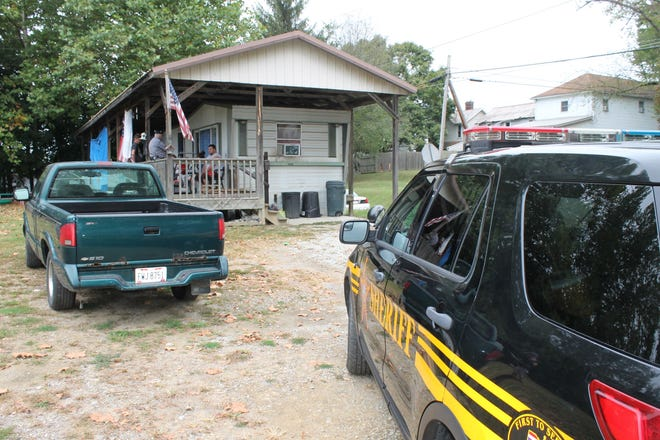Local law enforcement issued a search warrant in Crooksville Monday that resulted in two arrests.
