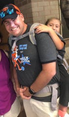 10-year-old Ryan Neighbors nearly missed a class field trip because she needs a wheelchair to get around. Tully Elementary School teacher Jim Freeman carried her around in a special backpack.