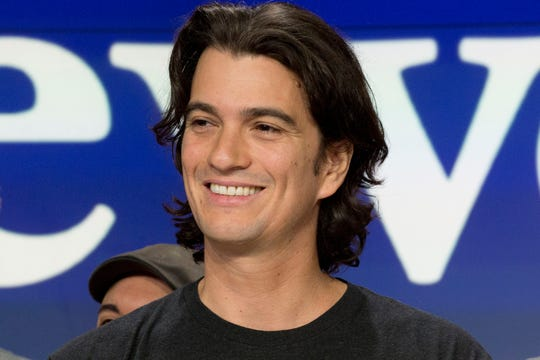 In this Jan. 16, 2018 file photo, Adam Neumann, co-founder and CEO of WeWork, attends the opening bell ceremony at Nasdaq, in New York. Neumann is stepping aside amid questions about the company's finances. The New York-based office sharing company said Neumann will remain on its board as non-executive chairman.