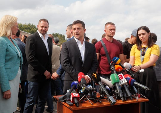 Ukrainian President Volodymyr Zelenskiy (C) speaks to media on Sept. 7, 2019.