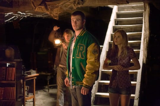 A group of teens (including, from left, Fran Kranz, Chris Hemsworth and Anna Hutchison) venture to a cabin in the woods. Things go off the rails quickly as they fall victim to backwoods zombies.