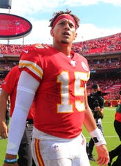 Kansas City Chiefs quarterback Patrick Mahomes (15) leaves the field after defeating the Baltimore Ravens at Arrowhead Stadium.