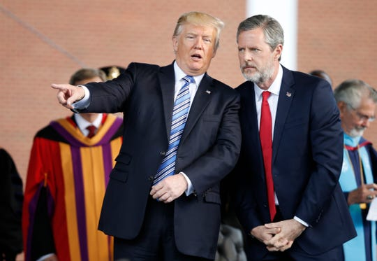 President Donald Trump and Liberty University President Jerry Falwell Jr. during commencement proceedings on May 13, 2017.