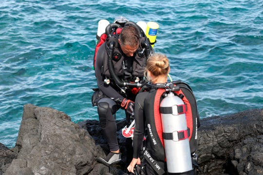 Researchers prepare to dive near Captain Cook. The water there is about three and a half degrees above normal for this time of year. Coral can recover from bleaching, but when it is exposed to heat over several years, the likelihood of survival decreases.