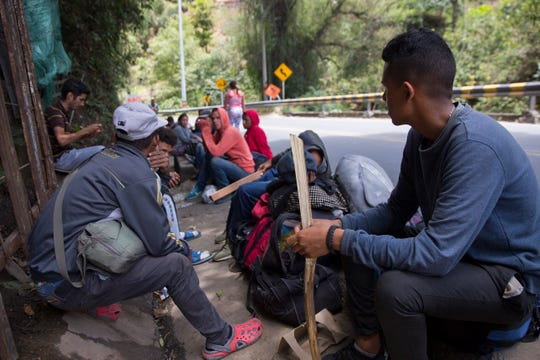 A group of young Venezuelan migrants rest on the side of highway in Colombia running from the Venezuela border on September 12, 2019. A growing number of migrants begin hundreds, sometimes thousand-mile journeys walking from their collapsing country.