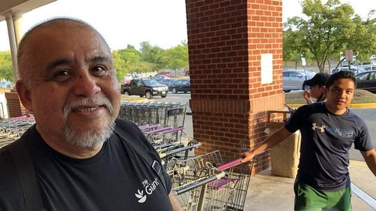 Wilber Ruiz, left, hoped to retire to his native Peru by now, but at 67 he's still at work retrieving carts and greeting customers at a Giant supermarket in Ashburn, Virginia.