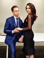 "Patrick J. Adams as Michael Ross and Meghan Markle as Rachel Zane on Season 5 of ""Suits."""