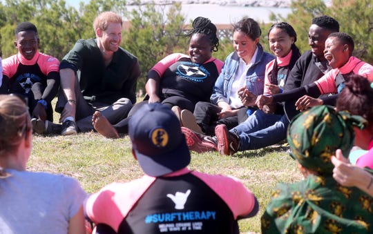Prince Harry and Duchess Meghan with visiting Waves for Change on Sept. 24, 2019 in Cape Town.