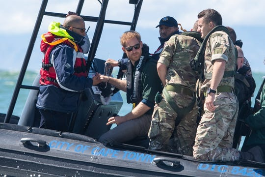 Prince Harry traveled with Royal Marines and Cape Town maritime police to Seal Island in Kalk Bay off Cape Town, South Africa, to learn efforts to combat abalone poaching, on Sept. 24, 2019, on the second day of the Duke and Duchess of Sussex's tour of southern Africa.