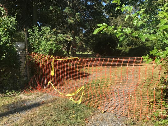 Snow fencing blocks the entrance to the Shaheen property at 310 Norwood Ave. on Sept. 25. The century-old mansion on the property burned down in July.