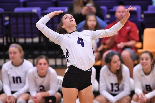 Wylie's Karis Christian (4) spent the first three months of the school year in a volleyball uniform, she traded it in for basketball three days after the season ended.