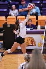 Clyde junior Peyton Warren pushes the ball over the net against Wylie on Sept. 24 at Bulldog Gym in Abilene.