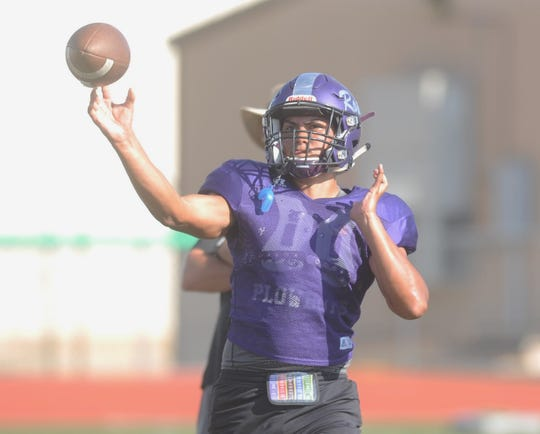 Roscoe quarterback Junior Martinez throws a pass during practice Tuesday at Plowboy Field.