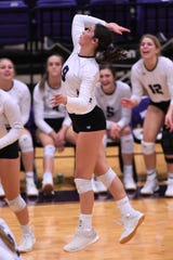 Wylie's Keetyn Davis (9) goes up for a kill against Clyde at Bulldog Gym on Tuesday. It was the second match back at full strength for Davis who missed two weeks this season with an injury. The Lady Bulldogs host Aledo on Friday in the District 4-5A opener.