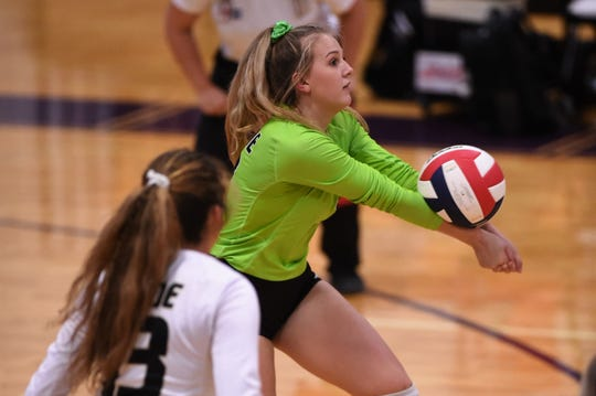 Clyde libero Megan Latham bumps a pass against Wylie on Sept. 24 at Bulldog Gym in Abilene.