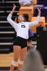 Clyde's Peyton Warren goes for a kill against Wylie on Sept. 24 at Bulldog Gym in Abilene.