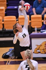 Clyde's Kaitlyn Turner (13) spikes the ball against Wylie at Bulldog Gym on Tuesday. Turner finished with four kills and two aces in the three-set loss.