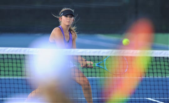 Wylie's Kindall Alford chases down a shot at the net during her girls doubles match against Cooper's Helena Bridge and Kaylee Connally. Alford and Sophia Lieu won the match 6-2, 6-4. Wylie won the District 4-5A match 19-0 over Cooper on Tuesday, Sept. 24, 2019, at the Wylie courts.
