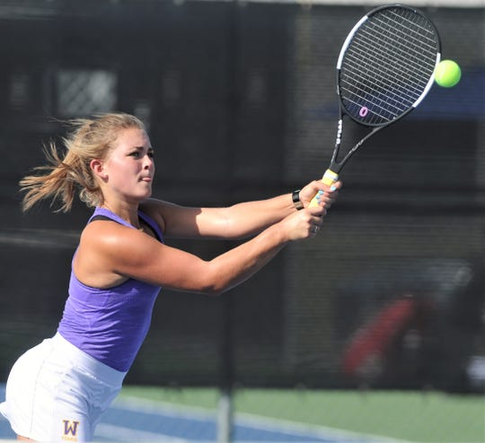 Wylie's Leighton Alford hits a shot during her girls doubles match against Cooper's Josephine Bandora and Byrin Hollowell. Alford and Analeah Elias won 6-3, 6-1 as part of Wylie's 19-0 victory over Cooper in the District 4-5A match Tuesday, Sept. 24, 2019, at the Wylie courts.