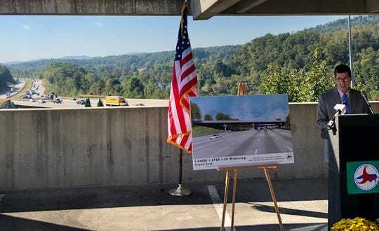 With Interstate 26 in the background, N.C. DOT Division Engineer Brian Burch talks about the widening of the major east-west corridor, which will begin this month. Burch's division includes the Henderson County portion of the project.